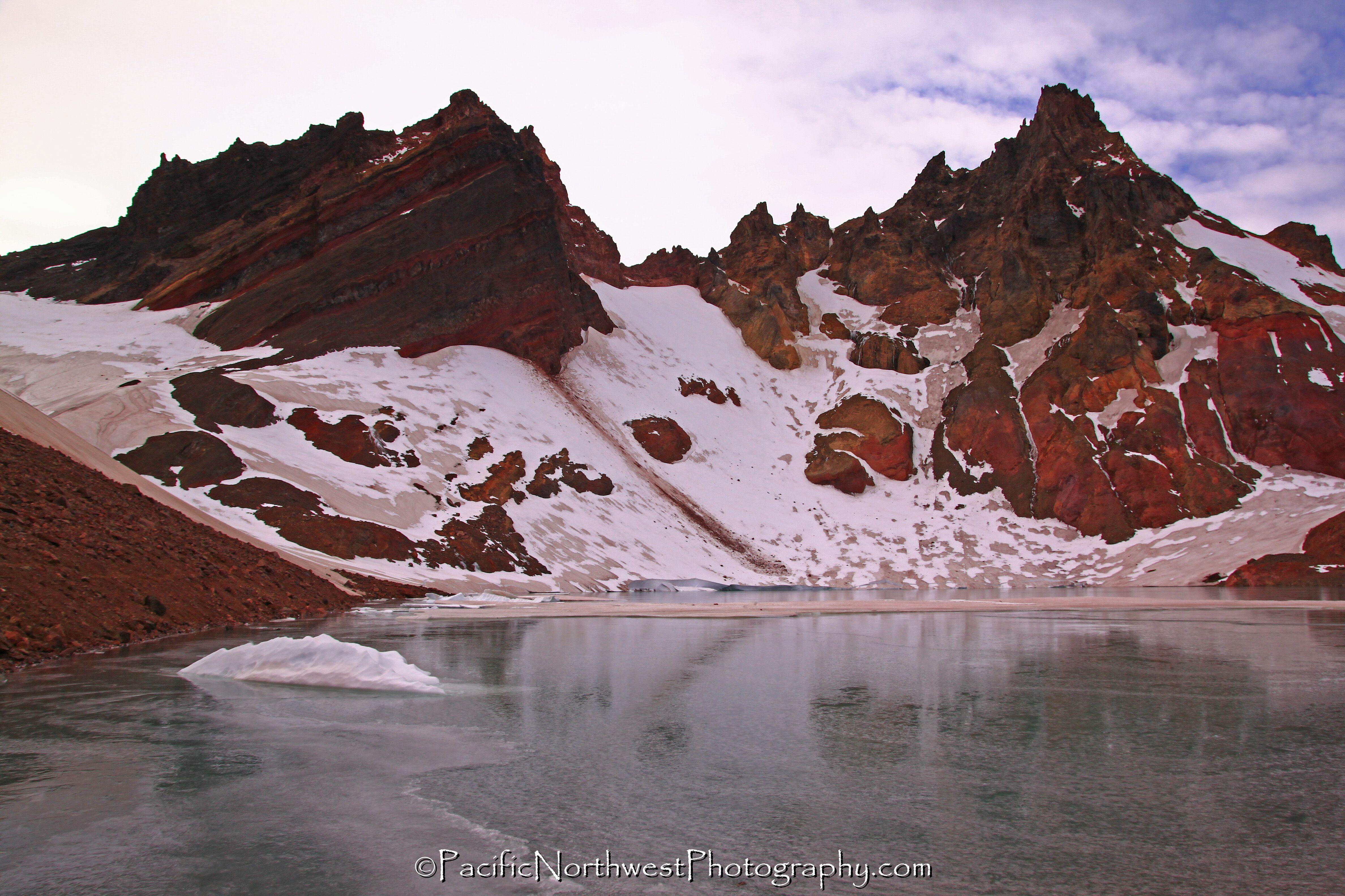 Volcano, glacier and frozen alpine lake